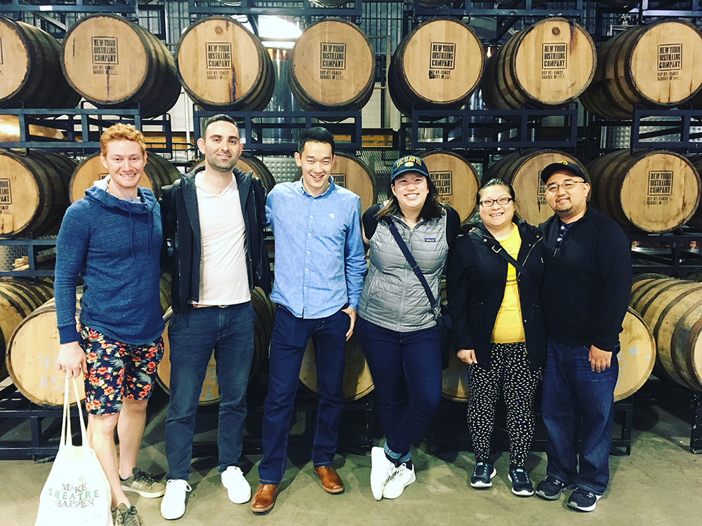New York UC Davis alumni posing in a distillery