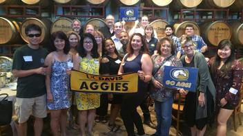 Group of Aggies with UC Davis banner