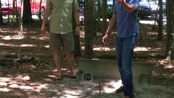 Two men playing bean bag toss