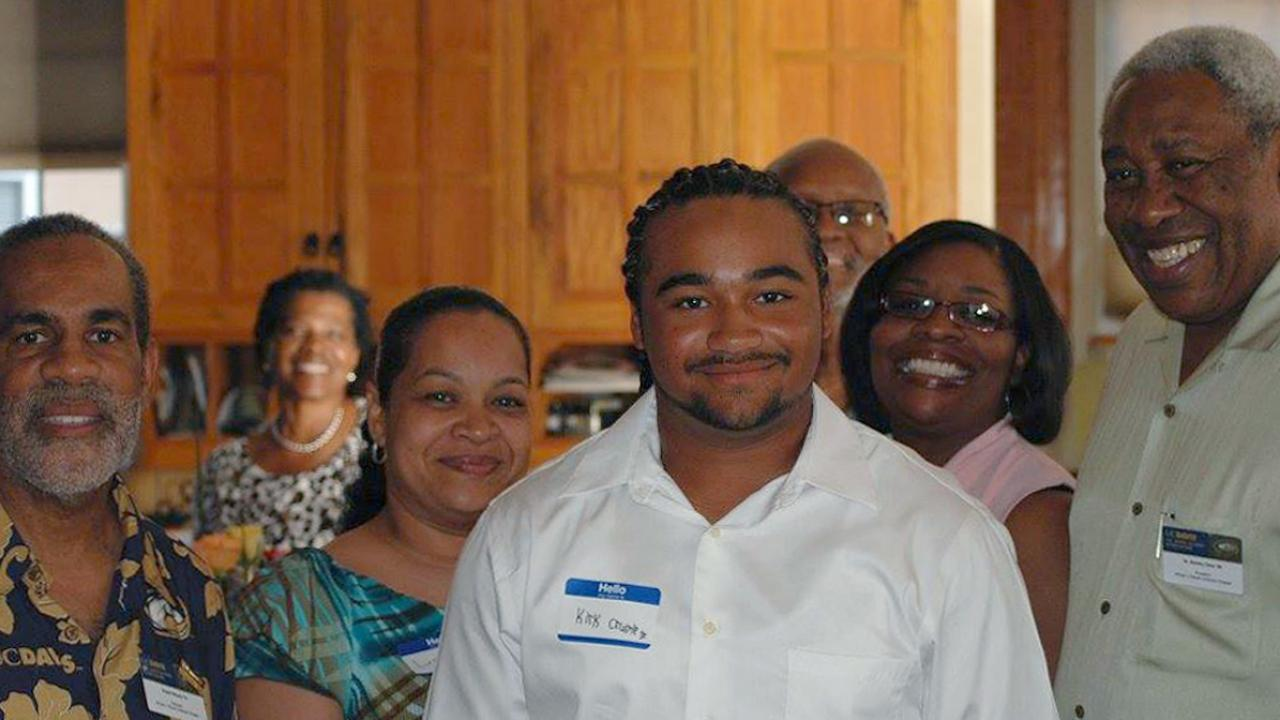 UC Davis freshman Kirk Crump and members of the UC Davis Cal Aggie African and African American Alumni Association (5A)