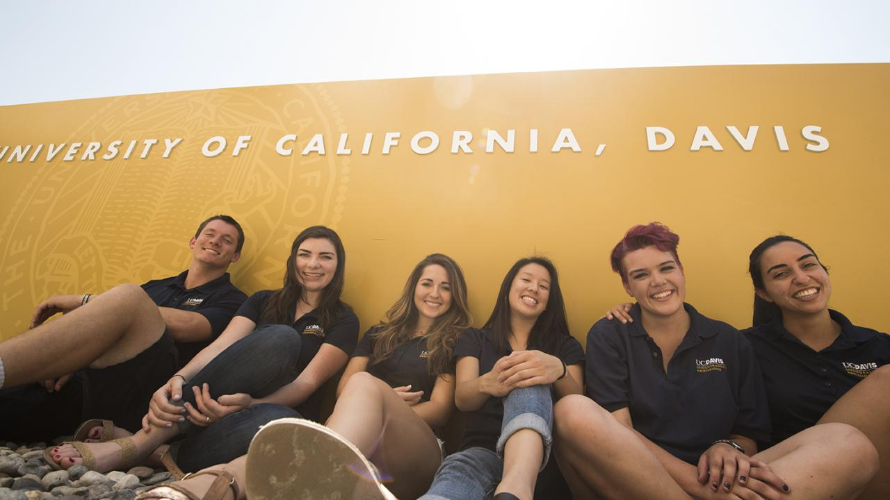 Students in front of a UC Davis sign