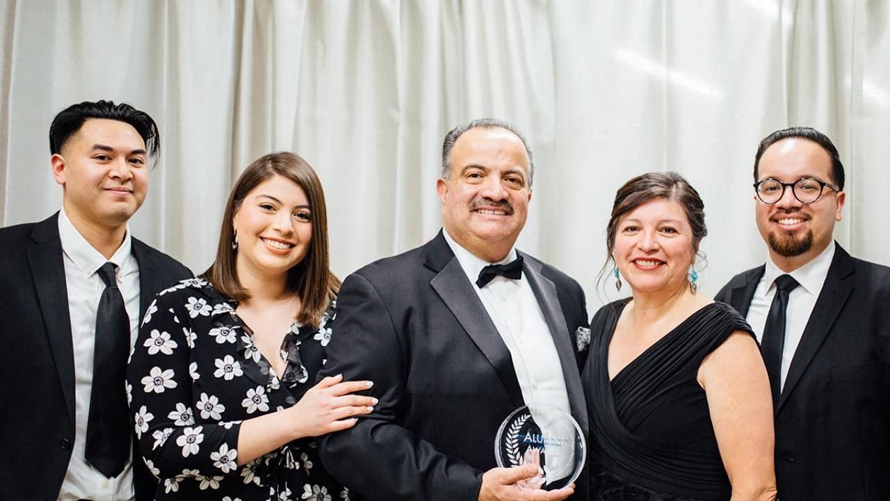 UC Davis Alumni Award honoree Francisco Rodriguez poses with family at Betty Irene Moore Hall School of Nursing