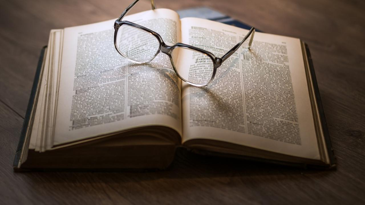 eye glasses on a book