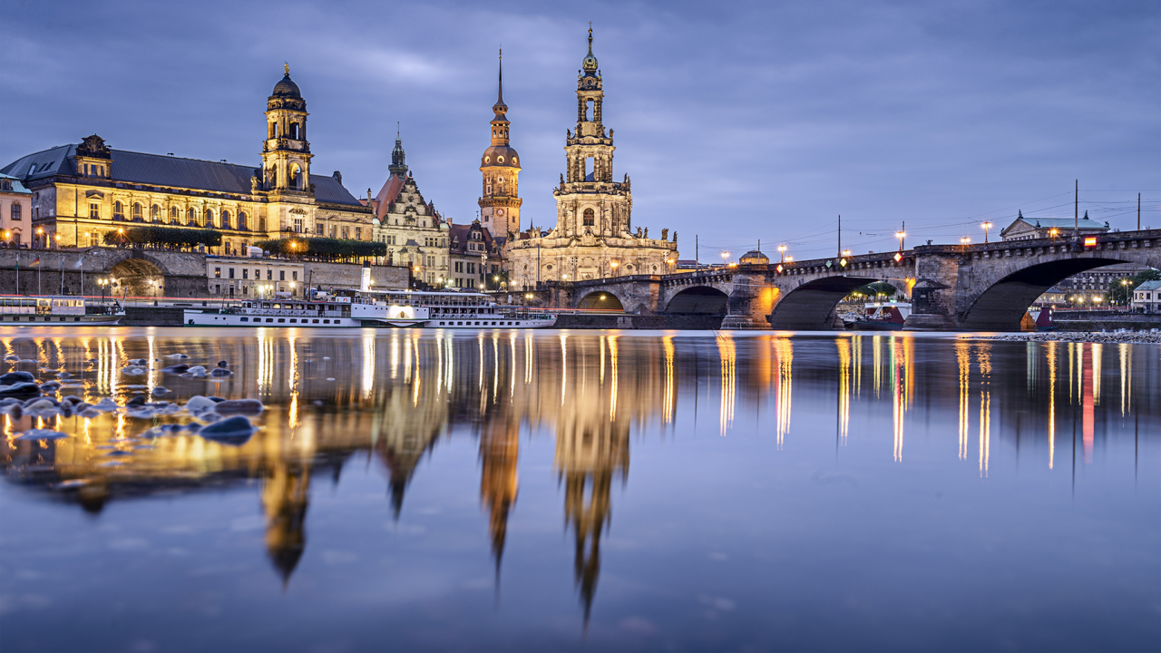 Night view of Dresden, Germany with reflective water.