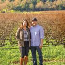 Gina and Jake Stover pose in front of their vineyard