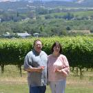 John Bucher '84 and his wife Diane of Bucher Wines posing in front of their vineyard