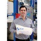Nolan de Graaff holds a bag of ice from Ice Now LLC