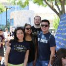 Four UC Davis alumni posing for the camera